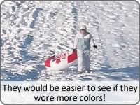 This person is creating a sledding hazard because their clothes blend into the sledding hill.