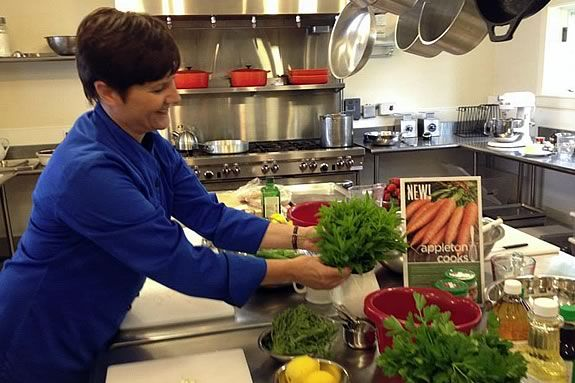 Chef-teacher Carolyn Grieco preparing the work stations for the hands-on workshop