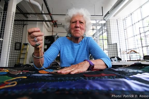 Clara Wainwright works on the Mending Boston Collage Quilt. Photo: PD Rosso
