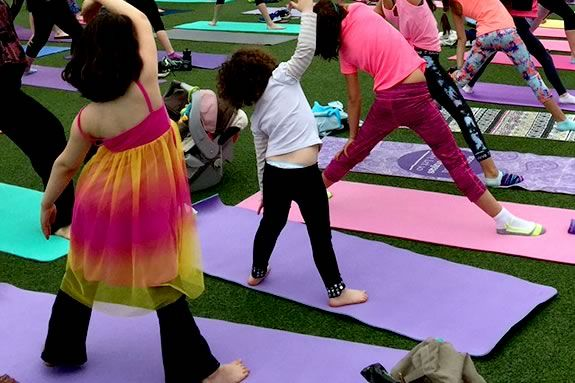 Join Solstice Power Yoga and Athleta Lynnfield at MarketStreet Lynnfield for Kids Yoga on the Green!