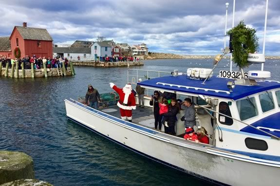 Santa comes to Rockport Ma by lobster boat to kick off the Holiday season in Rockport Massachusetts!