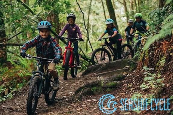 Join Seaside Cycle on a family bike ride in the woods of Grodon College in Beverly Massachusetts